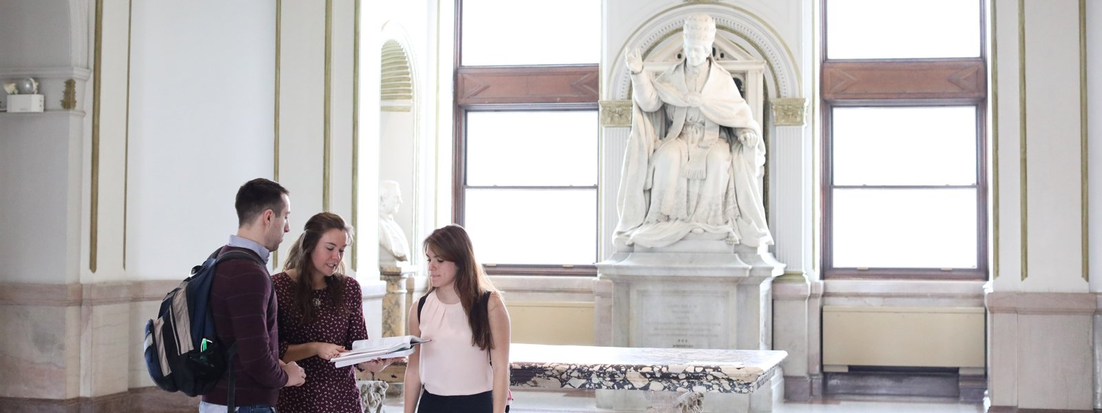 Students with statue of Pope Leo XIII