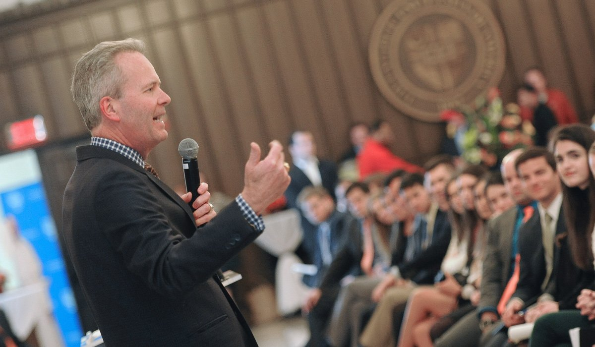 Tim Busch addressing students